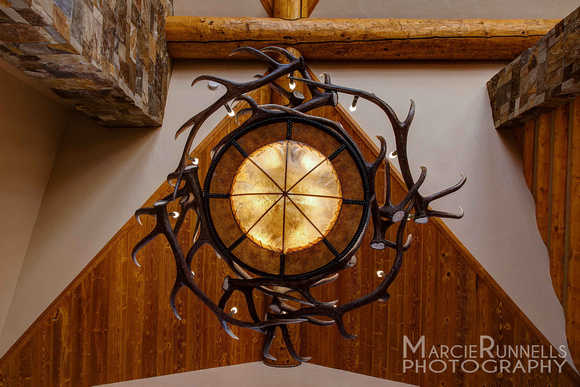 Naturally shed antler chandelier at the front entry of this beautiful Woodland Park, CO mountain home.  Artist, Jeff Musgrave