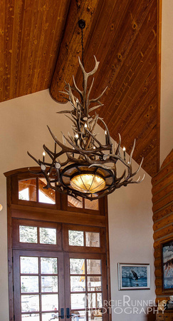 Naturally shed antler chandelier in the front entry of this beautiful Woodland Park, CO mountain home. Artist, Jeff Musgrave