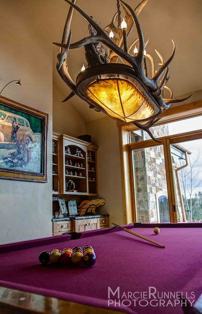 Naturally shed antler chandelier over the pool table of this beautiful Woodland Park, CO mountain home. Artist, Jeff Musgrave